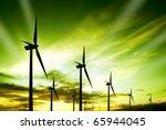 wind turbines farm at sunset | Shutterstock . vector #65944045