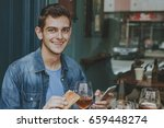young man mobile drinking beer | Shutterstock . vector #659448274