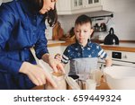mother and son baking cake in... | Shutterstock . vector #659449324