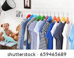 clothes on hangers in the room | Shutterstock . vector #659465689