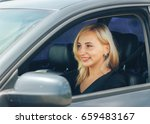 beautiful blonde smiling behind ... | Shutterstock . vector #659483167