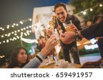 happy group of friends toasting ... | Shutterstock . vector #659491957
