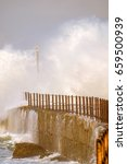 Small photo of Waves come crashing into the pier of the Kowie River in Port Alfred during a major storm
