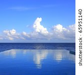 cloud reflections on the infinity pool - stock photo