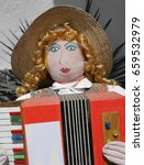 Small photo of Puppets in Monferrato country, Piedmont, Italy, Accordionist close-up