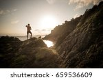 man hiking on a mountain over... | Shutterstock . vector #659536609