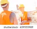 happy supervisor discussing... | Shutterstock . vector #659555989