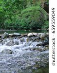 Small photo of river, rocks, trees(the region called ida mountains)