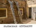 carved wooden ladder in ende... | Shutterstock . vector #659566399