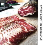 Small photo of Capocollo coppa is a traditional Italian and Corsican pork cold cut made from the dry cured muscle running from the neck