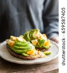 whole grain toasts with avocado ... | Shutterstock . vector #659587405