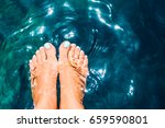 pair of woman's feet with light ... | Shutterstock . vector #659590801