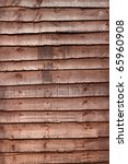 Brown Panels In A Wooden Fence.