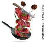 flying raw steaks  with... | Shutterstock . vector #659614249