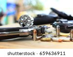 pistol and bullet on table... | Shutterstock . vector #659636911