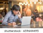 young asian business man... | Shutterstock . vector #659644495