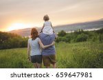 a young father and mother with... | Shutterstock . vector #659647981
