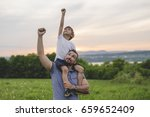 a father and son having fun... | Shutterstock . vector #659652409