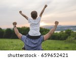 a father and son having fun... | Shutterstock . vector #659652421