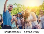 couple flirting at the party | Shutterstock . vector #659656909