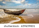 solitary wooden fishing boat at ...   Shutterstock . vector #659659831