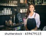 Asian Women Barista Smiling An...