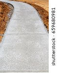 newly poured concrete sidewalk... | Shutterstock . vector #659680981
