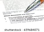Small photo of Visa application requirement list with silver ballpoint