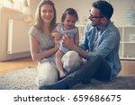 happy family sitting on floor... | Shutterstock . vector #659686675
