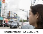 the woman looked at the road. | Shutterstock . vector #659687275