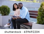 bright modern couple enjoying... | Shutterstock . vector #659692204