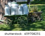 Several Old Milk Churns On A...