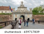 Small photo of ALBA IULIA, ROMANIA - APRIL 29, 2017: View at principal gate for entrance in medieval fortress of Alba Iulia (Carolina),Transylvania, Romania. Bridge, soldier and tourists in front.