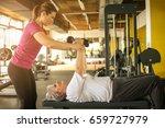 personal trainer working... | Shutterstock . vector #659727979