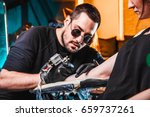 master tattooist makes a tattoo ... | Shutterstock . vector #659737261