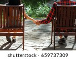 the guy with the girl sitting... | Shutterstock . vector #659737309