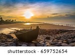 wooden boat on the beach rocks... | Shutterstock . vector #659752654