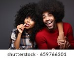happy couple doing funny faces... | Shutterstock . vector #659766301