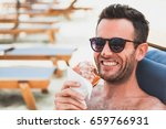 young man eating chocolate...   Shutterstock . vector #659766931