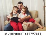 father with daughter at home | Shutterstock . vector #659797855