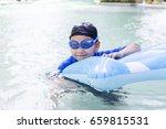 boy swimming pool | Shutterstock . vector #659815531