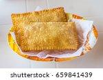 brazilian cheese pastel in a... | Shutterstock . vector #659841439