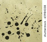 Splattered black ink stains on an old paper texture background - stock photo