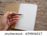 student hand writing on a blank ... | Shutterstock . vector #659846017