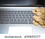 golden bitcoins on laptop... | Shutterstock . vector #659859277