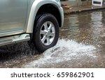wheels ran over the water  car... | Shutterstock . vector #659862901