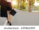 the graduating girl is walking... | Shutterstock . vector #659863309