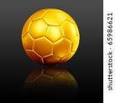 a golden soccer football with reflection on a black background - stock photo
