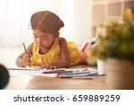 mixed race little girl lying on ... | Shutterstock . vector #659889259