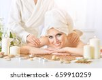 young woman having massage | Shutterstock . vector #659910259